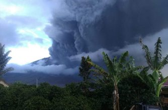 "This handout picture taken and released by Indonesia's Badan Nasional Penanggulangan Bencana (BNPB), the accident mitigation agency, on May 7, 2019 shows Mount Sinabung volcano spewing thick volcanic ash, as seen from Karo. - Sinabung roared back to life in 2010 for the first time in 400 years, after another period of inactivity it erupted once more in 2013, and has remained highly active since. (Photo by Handout / BADAN NASIONAL PENANGGULANGAN BENCANA (BNBP) / AFP) / ----EDITORS NOTE --- RESTRICTED TO EDITORIAL USE - MANDATORY CREDIT ""AFP PHOTO / BADAN NASIONAL PENANGGULANGAN BENCANA (BNBP)"" - NO MARKETING - NO ADVERTISING CAMPAIGNS - DISTRIBUTED AS A SERVICE TO CLIENTS-"