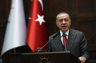 """President of Turkey and leader of Turkey's ruling Justice and Development (AK) Party Recep Tayyip Erdogan addresses party members during his party's parliamentary group meeting at the Grand National Assembly of Turkey on May 7, 2019 in Ankara. - Erdogan on May 7 welcomed a controversial order to re-run the recent Istanbul election after complaints of corruption as the """"best step"""" for the country. (Photo by Adem ALTAN / AFP)"""