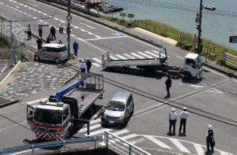 Police officers remove vehicles that ploughed into a group of kindergarten children leaving at least four of them critically injured at a crossing in Otsu, Shiga prefecture on May 8, 2019. - JAPAN OUT (Photo by JIJI PRESS / JIJI PRESS / AFP) / Japan OUT