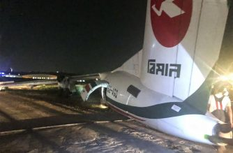 "This handout picture taken and released by Myanmar Department of Civil Aviation on May 8, 2019 shows a Biman Bangladesh airlines passenger after it slid off a runway at Yangon International airport in Yangon. - Eleven people were injured as a plane slid off a runway while landing at Yangon airport in Myanmar on May 8, police said, as a freak storm hit the city. (Photo by Handout / Myanmar Department of Civil Aviation / AFP) / -----EDITORS NOTE --- RESTRICTED TO EDITORIAL USE - MANDATORY CREDIT ""AFP PHOTO / MYANMAR DEPARTMENT OF CIVIL AVIATION"" - NO MARKETING - NO ADVERTISING CAMPAIGNS - DISTRIBUTED AS A SERVICE TO CLIENTS  -"