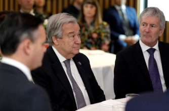 United Nations Secretary-General Antonio Guterres (C) sits with New Zealand's cabinet minister Damien O'Connor (R) during a climate change and agriculture event hosted by Ngai Tahu iwi and the Global Research Alliance on Agricultural Greenhouse Gases in Christchurch on May 14, 2019. - Guterres is on the final day of his three day visit to New Zealand as part of a trip to the South Pacific to highlight the problems of climate change. (Photo by Mark Baker / POOL / AFP)