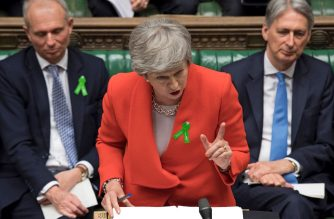 "A handout photograph taken and released by the UK Parliament on May 15, 2019 shows Britain's Prime Minister Theresa May speaking (C), during the weekly Prime Minister's Questions (PMQs) question and answer session in the House of Commons in London. (Photo by JESSICA TAYLOR / UK PARLIAMENT / AFP) / EDITORS NOTE THE IMAGE HAS BEEN DIGITALLY ALTERED AT SOURCE TO OBSCURE VISIBLE DOCUMENTS  - RESTRICTED TO EDITORIAL USE - NO USE FOR ENTERTAINMENT, SATIRICAL, ADVERTISING PURPOSES - MANDATORY CREDIT "" AFP PHOTO /JESSICA TAYLOR/ UK Parliament"""