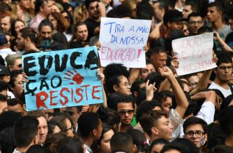 People demonstrate during a strike organized by the National Students Union (UNE) in Sao Paulo, Brazil on May 15, 2019. - Students and teachers from hundreds of universities and colleges across Brazil began a nationwide demonstration on Wednesday in 'defense of education' following a raft of budget cuts announced by President Jair Bolsonaro's government. (Photo by NELSON ALMEIDA / AFP)