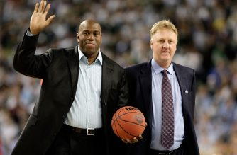 (FILES) In this file photo taken on April 6, 2009,  Larry Bird (R) and Earvin 'Magic' Johnson walk on the court to be honored for the 30th anniversary of their match up in 1979 NCAA Championship Game between Indiana State and Michigan State prior to the Michigan State Spartans playing against the North Carolina Tar Heels during the 2009 NCAA Division I Men's Basketball National Championship game at Ford Field in Detroit, Michigan. - Former rivals Magic Johnson and Larry Bird are to receive a joint Lifetime Achievement Award at the 2019 NBA Awards, the league announced on on may 15, 2019. (Photo by ANDY LYONS / GETTY IMAGES NORTH AMERICA / AFP)