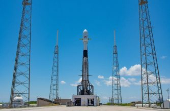 "This handout photo released by SpaceX on May 16, 2019 shows Falcon 9 ready for the second launch tentative of 60 Starlink satellites from Space Launch Complex 40 at Cape Canaveral Air Force Station in Cape Canaveral, Florida. - SpaceX postponed a launch of 60 satellites into low-Earth orbit that was scheduled for Thursday night May 16, 2019, possibly until next week, citing a need for software updates. (Photo by Handout / SPACEX / AFP) / RESTRICTED TO EDITORIAL USE - MANDATORY CREDIT ""AFP PHOTO / SPACEX "" - NO MARKETING NO ADVERTISING CAMPAIGNS - DISTRIBUTED AS A SERVICE TO CLIENTS"