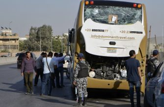 A picture taken on May 19, 2019, shows a bus damaged during a bomb blast near Egypt's famed Giza pyramids. - A bomb blast hit a tourist bus wounding at least 17 people, including South Africans, in the latest blow to the country's tourism industry. The roadside bomb went off as the bus was being driven in Giza, also causing injuries to Egyptians in a nearby car, medical and security sources said. (Photo by Sayed HASAN / AFP)