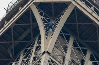 "A man (C) climbs up to the top of the Eiffel Tower, in Paris, without any protection, on May 20, 2019. - The Eiffel Tower was evacuated on May 20, 2019 in the afternoon after a person was spotted climbing up the Paris landmark, the company that operates the structure said. ""A climber has been spotted. It's the standard procedure: We have to stop the person, and in that case we evacuate the tower,"" an official told AFP, adding that police were on the scene. (Photo by FRANCOIS GUILLOT / AFP)"