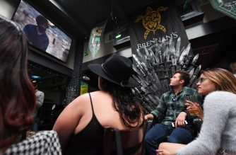 "(FILES) In this file photo taken on May 19, 2019 Fans watch HBO's ""Game of Thrones"" series finale at a viewing party at Brennan's bar in Marina del Rey, California. - The finale of ""Game of Thrones"" drew a staggering 19.3 million viewers in the US Sunday evening, cementing the fantasy epic's status as the most watched television series in HBO history. (Photo by Robyn Beck / AFP)"