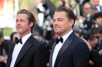"US actor Leonardo DiCaprio (R) arrives with US actor Brad Pitt for the screening of the film ""Once Upon a Time... in Hollywood"" at the 72nd edition of the Cannes Film Festival in Cannes, southern France, on May 21, 2019. (Photo by Valery HACHE / AFP)"