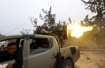 Fighters loyal to the Libyan internationally-recognised Government of National Accord (GNA) fire a heavy machine gun during clashes against forces loyal to strongman Khalifa Haftar, on May 21, 2019 in the Salah al-Din area south of the Libyan capital Tripoli. - Despite a UN embargo, weapons are still flowing into Libya where an assault on the capital by Haftar threatens to escalate into a proxy war between regional powers. Haftar, whose self-styled Libyan National Army (LNA) is allied with an administration in eastern Libya, is supported especially by Egypt and the United Arab Emirates (UAE). (Photo by Mahmud TURKIA / AFP)