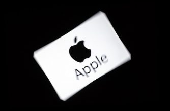 "(FILES) In this file photo taken on February 18, 2019 US multinational technology company Apple's logo is displayed on a tablet in Paris. - French Senate approved in the night between May 21 and May 22, 2019 a new tax on digital giants (""Gafa""), such as Google, Amazon, Facebook and Apple, carried through Finance Minister Bruno Le Maire. (Photo by Lionel BONAVENTURE / AFP)"