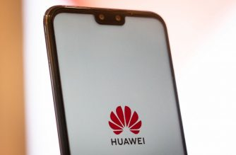A Huawei logo is displayed on a smartphone at a retail store in Beijing on May 23, 2019. - Chinese telecom giant Huawei says it could roll out its own operating system for smartphones and laptops in China by the autumn after the United States blacklisted the company, a report said on May 23. (Photo by FRED DUFOUR / AFP)