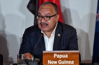 (FILES) In this file photo taken on November 18, 2018 Papua New Guinea's Prime Minister Peter O'Neill speaks at an electricity projects signing ceremony during the Asia-Pacific Economic Cooperation (APEC) Summit in Port Moresby. - O'Neill resigned on May 26, 2019. (Photo by SAEED KHAN / AFP)