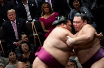 US President Donald Trump (L) First Lady Melania Trump (C) and Japan's Prime Minister Shinzo Abe' Akie Abe (R) watch a sumo battle during the Summer Grand Sumo Tournament in Tokyo on May 26, 2019. (Photo by Brendan SMIALOWSKI / AFP)