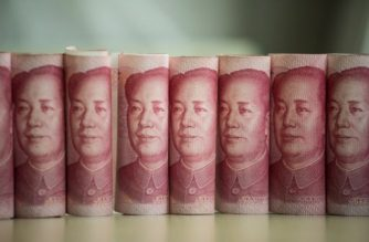 This photo illustration taken on January 6, 2017 shows Chinese 100 yuan notes in Beijing - China just raised the exchange rate for the yuan against the US dollar by 0.92 percent from the previous day, the biggest one-day increase in more than 11 years. (Photo by FRED DUFOUR / AFP)