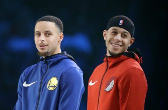 CHARLOTTE, NORTH CAROLINA - FEBRUARY 16: (L-R) Stephen Curry #30 of the Golden State Warriors and Seth Curry #31 of the Portland Trail Blazers look on before the MTN DEW 3-Point Contest as part of the 2019 NBA All-Star Weekend at Spectrum Center on February 16, 2019 in Charlotte, North Carolina.   Streeter Lecka/Getty Images/AFP