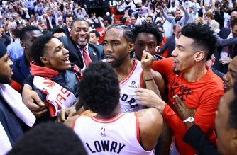 Kawhi Leonard #2 of the Toronto Raptors celebrates with teammates after sinking a buzzer beater to win Game Seven of the second round of the 2019 NBA Playoffs against the Philadelphia 76ers at Scotiabank Arena on May 12, 2019 in Toronto, Canada. Vaughn Ridley/Getty Images/AFP
