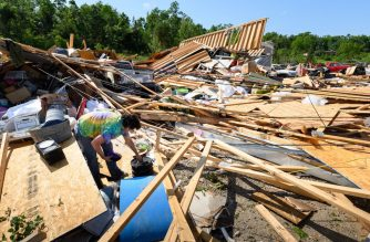 JEFFERSON CITY, MO - MAY 23: Dee Raithel sorts through the remains of a storage unit looking for her possessions on May 23, 2019 in Jefferson City, Missouri. A tornado hit the area late Thursday night. A series of powerful tornadoes killed at least three people in southwestern Missouri causing extensive damage in Jefferson City, the state capital.   Reed Hoffmann/Getty Images/AFP
