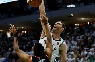 MILWAUKEE, WISCONSIN - MAY 15: Brook Lopez #11 of the Milwaukee Bucks dunks the ball over Kyle Lowry #7 of the Toronto Raptors in the fourth quarter in Game One of the Eastern Conference Finals of the 2019 NBA Playoffs at the Fiserv Forum on May 15, 2019 in Milwaukee, Wisconsin. NOTE TO USER: User expressly acknowledges and agrees that, by downloading and or using this photograph, User is consenting to the terms and conditions of the Getty Images License Agreement.   Jonathan Daniel/Getty Images/AFP