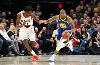 PORTLAND, OREGON - MAY 18: Andre Iguodala #9 of the Golden State Warriors dribbles against Al-Farouq Aminu #8 of the Portland Trail Blazers during the first half in game three of the NBA Western Conference Finals at Moda Center on May 18, 2019 in Portland, Oregon. NOTE TO USER: User expressly acknowledges and agrees that, by downloading and or using this photograph, User is consenting to the terms and conditions of the Getty Images License Agreement.   Steve Dykes/Getty Images/AFP