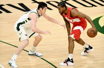 MILWAUKEE, WISCONSIN - MAY 23: Kawhi Leonard #2 of the Toronto Raptors dribbles the ball while being guarded by Ersan Ilyasova #77 of the Milwaukee Bucks in the fourth quarter during Game Five of the Eastern Conference Finals of the 2019 NBA Playoffs at the Fiserv Forum on May 23, 2019 in Milwaukee, Wisconsin. NOTE TO USER: User expressly acknowledges and agrees that, by downloading and or using this photograph, User is consenting to the terms and conditions of the Getty Images License Agreement.   Stacy Revere/Getty Images/AFP