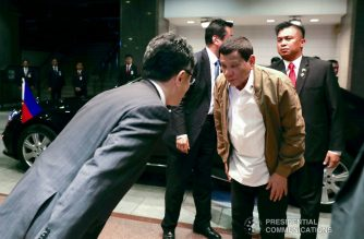 President Rodrigo Roa Duterte shows a gesture of respect to a member of the reception party upon his arrival at a hotel in Tokyo, Japan on May 28, 2019. RICHARD MADELO/PRESIDENTIAL PHOTO