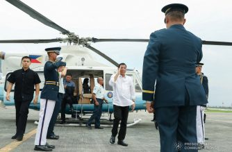 President Rodrigo Duterte salutes a military officer as he prepares to board a plane bound for Japan at the Villamor Air Base in Pasay City on May 28, 2019. The President is set to participate in the 25th Nikkei Conference on the Future of Asia in Tokyo. REY BANIQUET/PRESIDENTIAL PHOTO