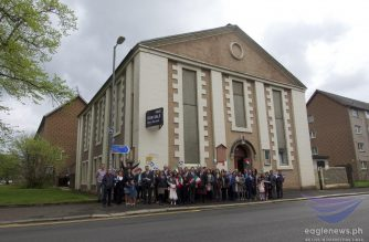 Iglesia Ni Cristo (Church Of Christ) members pose for a photo in front of a 200-year old church building that was recently purchased by the INC from the building's previous owner, the New Jerusalem Church.  This church edifice is located at 17 George Street in Paisley, Scotland.  (Photo courtesy EBC Europe Bureau/ Eagle News Service)