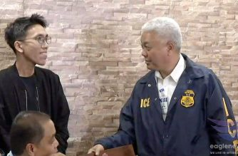 """NBI spokesperson Deputy Director Ferdinand Lavin speaks to Rodel Jayme, who put up the website metrobalita.net which had been used to spread the Youtube videos of """"Bikoy.""""  (Eagle News Service)"""