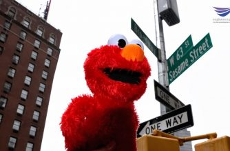Photo of Sesame Street Muppet doll Elmo in front of the new street sign. Photo by Emil Valerio, EBC New York Bureau, Eagle News Service.