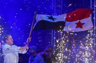 Panama's presidential candidate Laurentino Cortizo, of the Democratic Revolutionary Party (PRD), waves a Panamanian national flag during his closing campaign rally in Panama City on May 1, 2019. - Panama holds presidential elections on May 5. (Photo by Luis ACOSTA / AFP)
