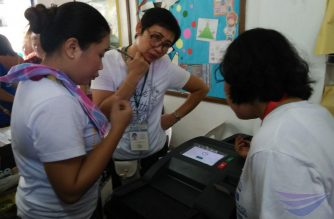A vote counting machine in a polling precinct in San Rafael, Rodriguez, Rizal which is reportedly experiencing errors,  (Photo by Eagle News correspondent Rowena Sahay/Eagle News Service)