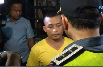 Cpl. Rocky delos Reyes, the Caloocan City policeman who fatally shot a six-year old boy in Camarin, Caloocan on Sunday, April 28, 2019, is scolded by Philippine National Police National Capital Region Office chief Major Gen. Guillermo Eleazar.  (Eagle News Service)