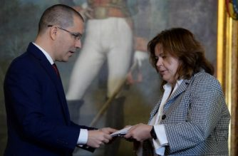 Venezuela's Foreign Minister Jorge Arreaza (L) talks with the representative of embassy of Canada, member of the Lima Group, Lori Corrivean, during a meeting to present a protest letter, at the Foreign Ministry in Caracas on January 9, 2019. - With the exception of Mexico, the Lima Group -- made up of 14 mostly Latin American countries -- has urged Maduro to renounce his second term and deliver power to parliament, a demand Caracas blasted as incitement to stage a coup d'etat. Maduro will begin his second mandate on January 10 plagued by accusations of illegitimacy and increasing international isolation in a country crippled by an economic crisis. (Photo by Federico PARRA / AFP)