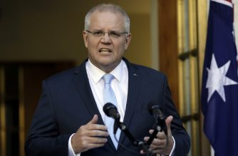 Australia's Prime Minister Scott Morrison speaks at a press conference at the Parliament House in Canberra on April 11, 2019. - Australia's Prime Minister Scott Morrison on Thursday called a national election for May 18, firing the starting gun on a campaign set to focus heavily on climate and the economy. The vote will decide whether the conservative government gets a rare third term in office -- and whether Morrison can beat the odds and hang on to power. (Photo by SEAN DAVEY / AFP)