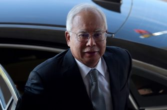 Malaysia's former prime minister Najib Razak arrives at the Kuala Lumpur High Court for his trial over 1MDB corruption allegations in Kuala Lumpur on April 15, 2019. (Photo by STR / AFP) / Malaysia OUT