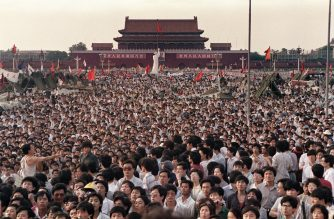 (FILES) This file photo taken on June 2, 1989 shows people gathered at Tiananmen Square during a pro-democracy protest in Beijing. - After seven weeks of protests by students and workers demanding democratic changes and the end of corruption, soldiers and tanks chased and killed demonstrators and onlookers in the streets leading to the square. But 30 years after the killings of June 4, 1989, the government still keeps a lid on what really happened and how many died on that fateful day. (Photo by CATHERINE HENRIETTE / AFP)
