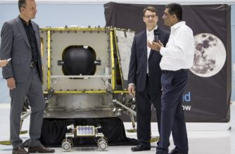 "In this handout photograph obtained courtesy of NASA, NASA Associate Administrator, Science Mission Directorate, Thomas Zurbuchen (L) speaks to President and CEO of OrbitBeyond, Siba Padhi (R) and Chief Science Officer, OrbitBeyond, Jon Morse, about their lunar lander, Friday, May 31, 2019, at Goddard Space Flight Center in Maryland. - Astrobotic, Intuitive Machines, and Orbit Beyond have been selected to provide the first lunar landers for the Artemis program's lunar surface exploration. (Photo by Aubrey GEMIGNANI / NASA / AFP) / == RESTRICTED TO EDITORIAL USE  / MANDATORY CREDIT:  ""AFP PHOTO / NASA / Aubrey GEMIGNANI"" / NO MARKETING / NO ADVERTISING CAMPAIGNS /  DISTRIBUTED AS A SERVICE TO CLIENTS  =="