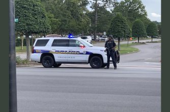 "In this image recieved from Lucretia Cunningham via @SouthsideDaily to AFP, a police officer blocks a road to the Virginia Beach municipal complex, the site of a mass shooting, in Virginia Beach, Virginia on May 31, 2019. - A gunman went on a shooting spree at a government building complex in Virginia Beach, Virginia, killing 11 people and wounding six, police said. The gunman, a longtime public utilities employee, was also killed after trading fire with responding officers, police chief James Cervera told a news conference. (Photo by Lucretia Cunningham / @SouthsideDaily / AFP) / RESTRICTED TO EDITORIAL USE - MANDATORY CREDIT ""AFP PHOTO / @SouthsideDaily/ Lucretia Cunningham"" - NO MARKETING NO ADVERTISING CAMPAIGNS - DISTRIBUTED AS A SERVICE TO CLIENTS"