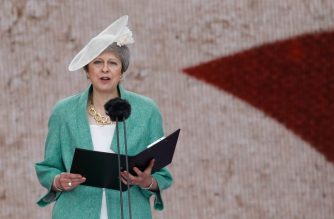 Britain's Prime Minister Theresa May stands and speaks as she reads a letter written by Captain Skinner, during an event to commemorate the 75th anniversary of the D-Day landings, in Portsmouth, southern England, on June 5, 2019. - US President Donald Trump, Queen Elizabeth II and 300 veterans are to gather on the south coast of England on Wednesday for a poignant ceremony marking the 75th anniversary of D-Day. Other world leaders will join them in Portsmouth for Britain's national event to commemorate the Allied invasion of the Normandy beaches in France -- one of the turning points of World War II. (Photo by Tolga AKMEN / AFP)
