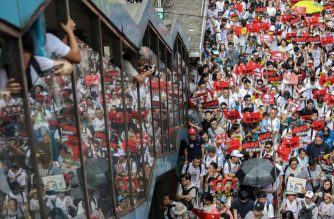 Protesters march during a rally against a controversial extradition law proposal in Hong Kong on June 9, 2019. - Huge protest crowds thronged Hong Kong on June 9 as anger swells over plans to allow extraditions to China, a proposal that has sparked the biggest public backlash against the city's pro-Beijing leadership in years. (Photo by DALE DE LA REY / AFP)