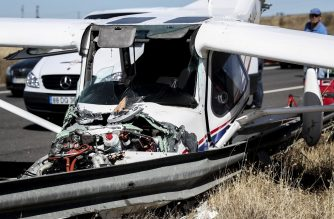 Wreckage of a small plane is pictured after crashing on a highway close to Pinhal Novo, on June 10, 2019. - A Pelican style tourist aircraft today made an emergency landing on a highway in the Lisbon area, causing a mild injured, local emergency services said. (Photo by CARLOS COSTA / AFP)