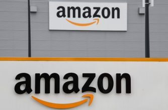 (FILES) In this file photo taken on March 04, 2019 shows the Amazon logo at the entrance area of the Amazon logistics centre in Lauwin-Planque, northern France. - US retail giant Amazon has moved past hi-tech titans Apple and Google to become the world's most valuable brand, a key survey showed June 10, 2019. (Photo by DENIS CHARLET / AFP)