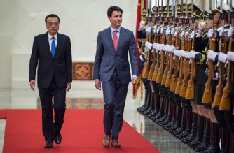 "(FILES) In this file photo taken on December 4, 2017, Canada's Prime Minister Justin Trudeau and China's Premier Li Keqiang (L) walk during a review of Chinese paramilitary guards at the Great Hall of the People in Beijing. - China ignored Trudeau's personal request for dialogue to end a spiralling diplomatic row, his office revealed on June 12, 2019. Trudeau requested the call in January with Premier Li Keqiang so he could ""personally advocate"" for the immediate release of two Canadians detained a month earlier and for clemency in the case of another Canadian who would later be sentenced to death for drug trafficking, his spokeswoman Chantal Gagnon said in a statement. (Photo by Fred DUFOUR / AFP)"