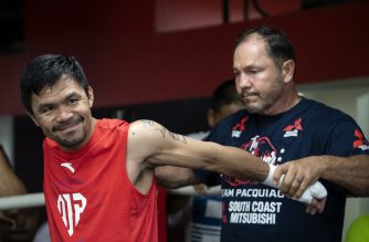 (FILES) In this file photo taken late on June 6, 2019 shows Philippine boxing icon Manny Pacquiao (L) training at a gym in Manila, ahead of his World Boxing Association title bout next month against Keith Thurman in Las Vegas. - Veteran promoter Bob Arum fears Filipino star Manny Pacquiao might be risking brain damage when he steps into the ring against WBA welterweight champion Keith Thurman in Las Vegas next month. Pacquiao, who turns 41 in December, will be facing one of his most dangerous opponents in years in the shape of Thurman, who is unbeaten in 30 fights and 10 years younger than the Filipino. (Photo by Noel CELIS / AFP)