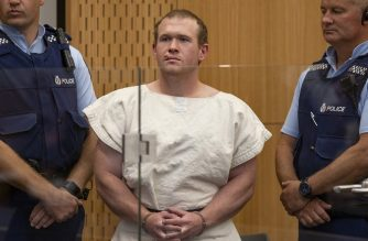 In this picture taken on March 16, 2019, Brenton Tarrant (C), the man charged in relation to the Christchurch massacre, stands in the dock during his appearance at the Christchurch District Court. - The man accused of shooting dead 51 Muslim worshippers in the Christchurch mosque attacks pleaded not guilty to multiple murder and terrorism charges on June 14, 2019 and was committed to stand trial next year. (Photo by Mark Mitchell / POOL / AFP)
