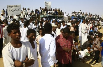 Supporters of the deputy head of Sudan's ruling Transitional Military Council (TMC) and commander of the Rapid Support Forces (RSF) paramilitaries gather to greet him upon his arrival in the village of Qarri, about 90 kilometres north of Khartoum, on June 15, 2019. (Photo by ASHRAF SHAZLY / AFP)