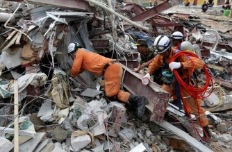 Rescue workers search for victims in the debris a day after an under-construction building collapsed in Sihanoukville on June 23, 2019. - Cambodian rescue workers picked through the rubble of a Chinese-owned building on June 23 in a desperate search for survivors after at least 17 people died when the under-construction building collapsed at a beach town. (Photo by SUN RETHY Kun / AFP)