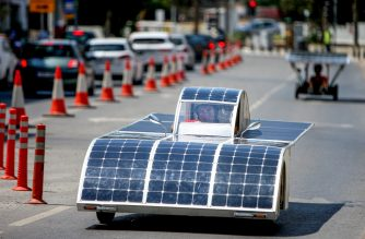 A Cypriot competitor steers his solar car during the Cyprus Institute's solar car challenge in Nicosia on June 23, 2019. - The solar car challenge was organized by Cyprus Institute to promote the use of renewable energy. Teams had to design and build a solar car for less than 20 000 euros. (Photo by Matthieu CLAVEL / AFP)