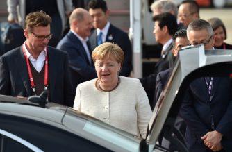 Germany's Chancellor Angela Merkel (C) arrives at at Kansai airport in Izumisano city, Osaka prefecture, on June 28, 2019 to attend the G20 Osaka Summit. (Photo by Kazuhiro NOGI / AFP)